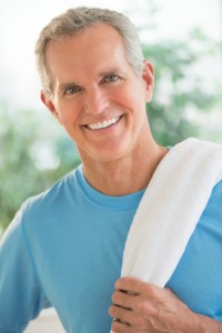 Portrait Of Happy Man With Towel On Shoulder
