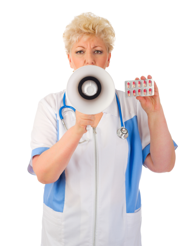 Mature doctor with megaphone and pills
