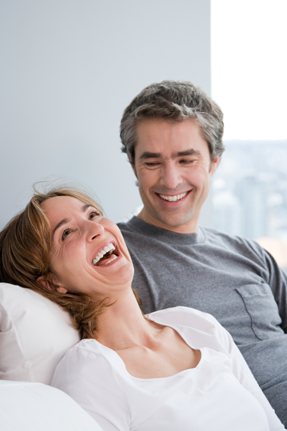 A mature couple laughing